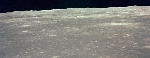 EARTHRISE IN THE MIDST OF A LUNAR DAY. - A NASA PHOTO FROM THE APOLLO 11 MISSION.