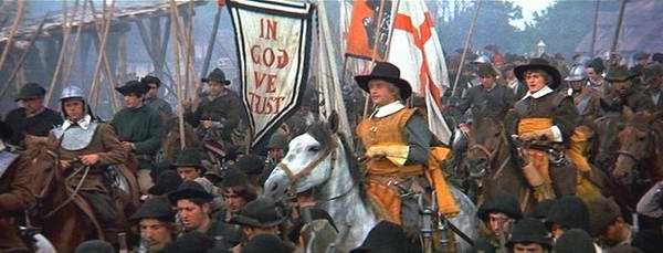 The Puritan Army goes off to war under the banner 'In God We Trust'.